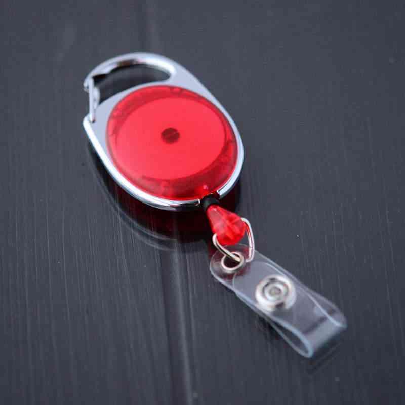 Punainen läpikuultava karabiinijojo vinyylilenkillä ja nepparilla esimerkiksi korttipidikkeelle