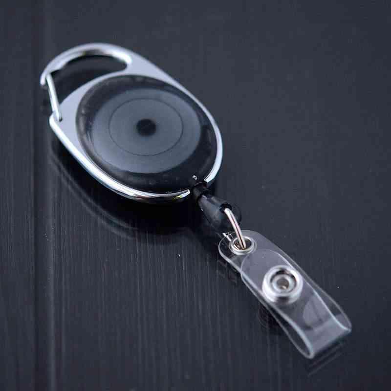 Musta läpikuultava karabiinijojo vinyylilenkillä ja nepparilla esimerkiksi korttipidikkeille